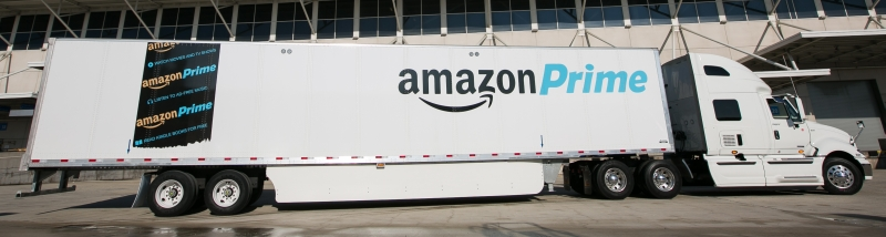 Amazon branded white trailer with side skirts between wheels